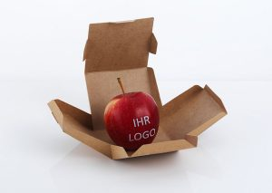 Apple with edible logo in sustainable box