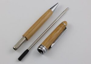 Environmentally friendly metal and bamboo ballpoint pen with refill metal cartridge