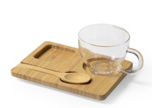 Glass cup with spoon and serving tray in environmentally friendly bamboo