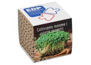 Plantegave-i-bølgepap---omslag-med-reklame